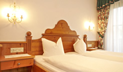 Cosy rooms with full-comfort facilities and balconies. Light friendly rooms with half board.